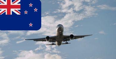 Avión en Vuelo sobre el cielo con la bandera de Nueva Zelanda